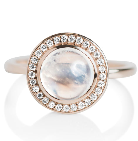 Moonstone cabochon right hand stack ring with a thin yellow gold band and a diamond halo