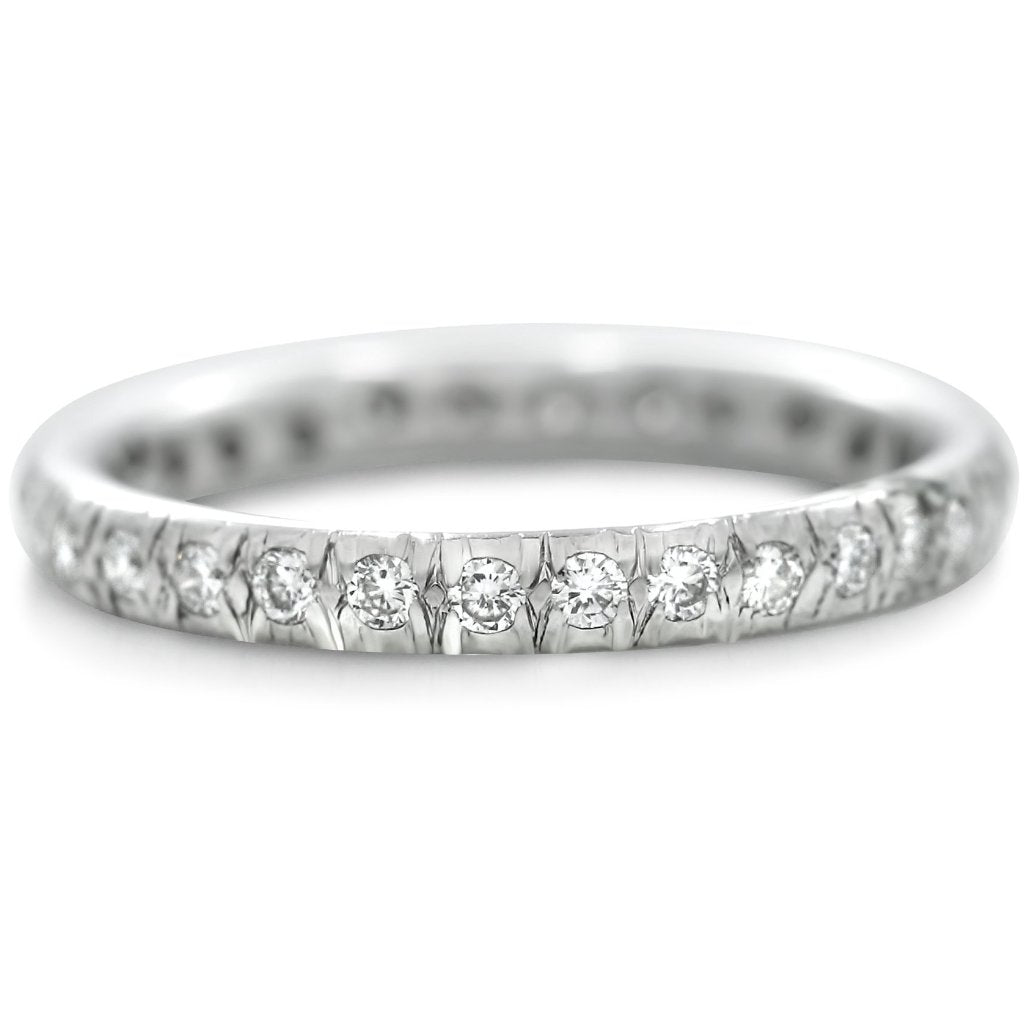 White gold and diamond estate wedding band with French set diamonds made in the 20th century.