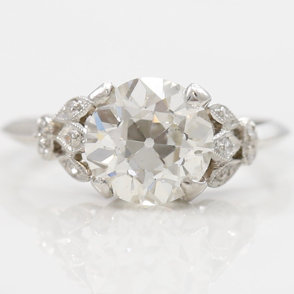 baguettes ring with a products flower estate upon platinum in diamond once
