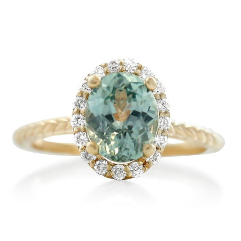 aquamarine right hand ring with diamond halo and yellow gold braided band