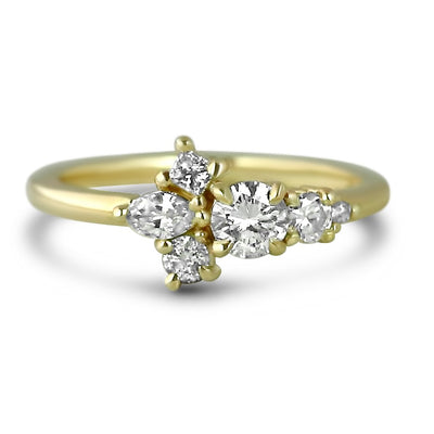 14k yellow gold cluster diamond ring with  a round brilliant cut center stone and marquise, round and princess cut diamond side stones