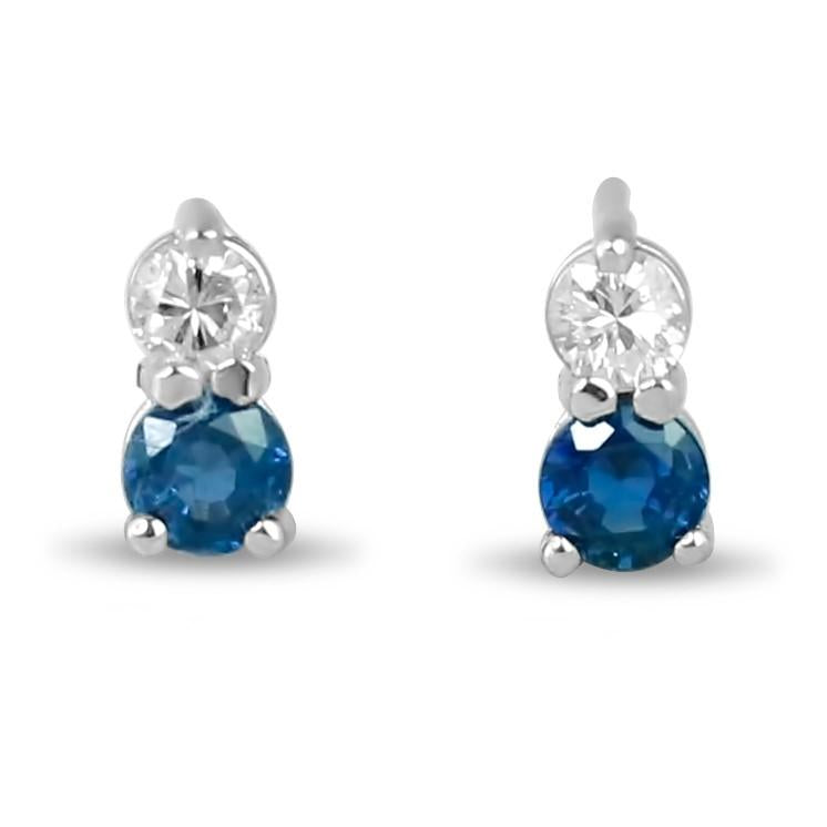 14k white gold prong set blue spphire and diamond stud earrings