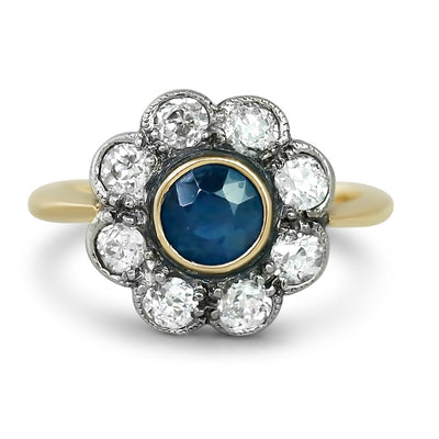 yellow gold and silver bezel set sapphire and diamond antique engagement ring with hand made milgrain