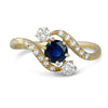 18k yellow gold bypass style antique engagement ring with a sapphire center stone and diamonds