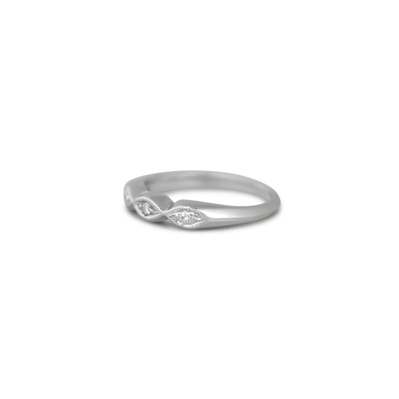 PLatinum estate wedding band with milgrain details and three dainty diamonds under 1000