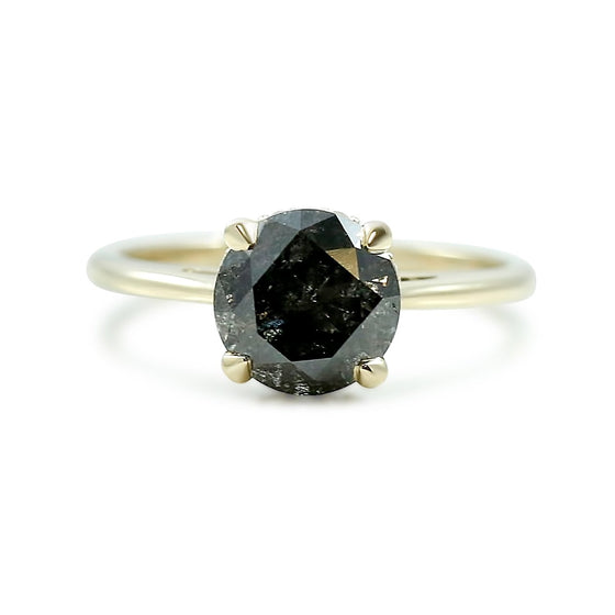galaxy diamond engagement ring with a hidden diamond halo and yellow gold band