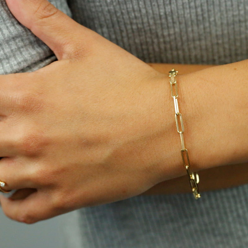 14k yellow gold chain link elongated bracelet 7in long and under $1000