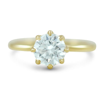 8 prong round diamond engagement ring with yellow gold band a hidden diamond halo also available in white or rose gold