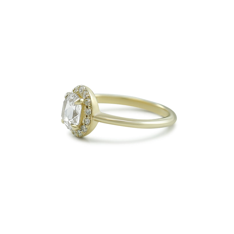 rose cut oval diamond engagement ring with a white diamond halo and thin yellow gold band
