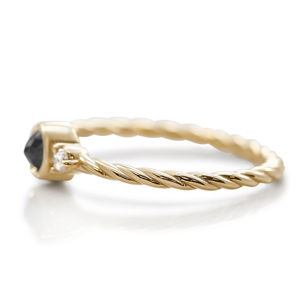 Black and white diamond stack ring with a yellow gold braided band