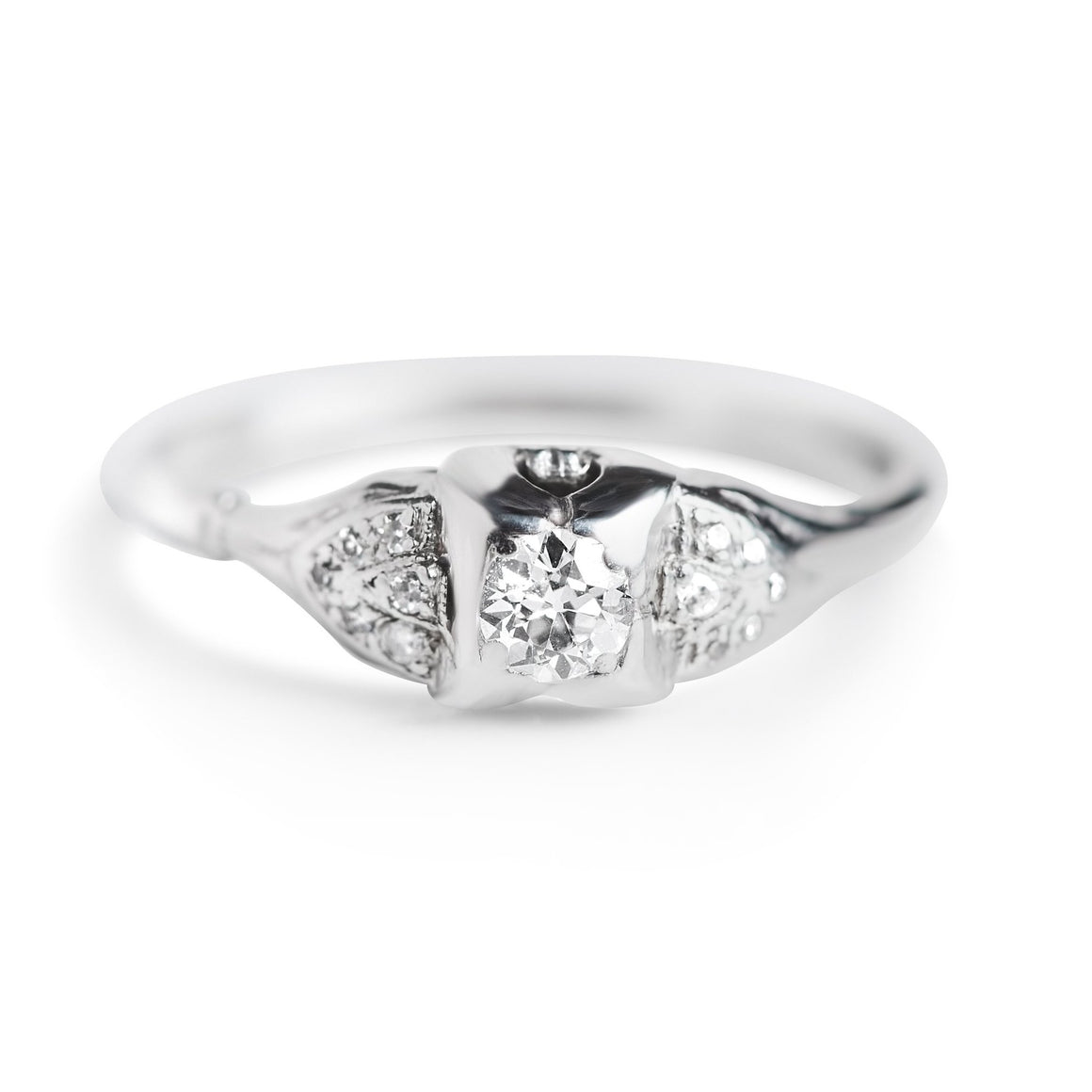 Platinum three stone estate engagement ring with old european cut diamonds
