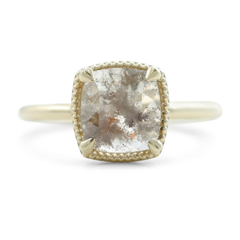 cushion and rose cut light gray diamond engagement ring prong set in 14k yellow gold with a milgrain halo