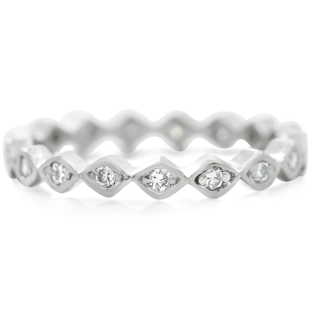 platinum antique eternity wedding band with platinum and diamonds made in the 1920s