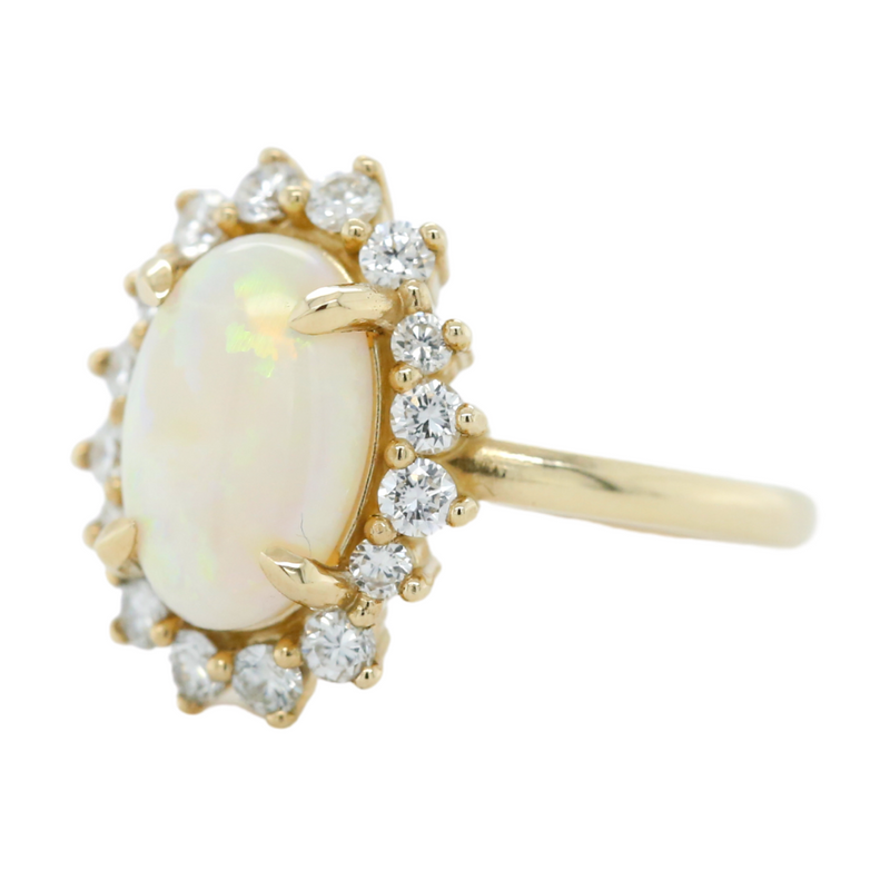 14k yellow gold white oval opal ring with a diamond flower halo