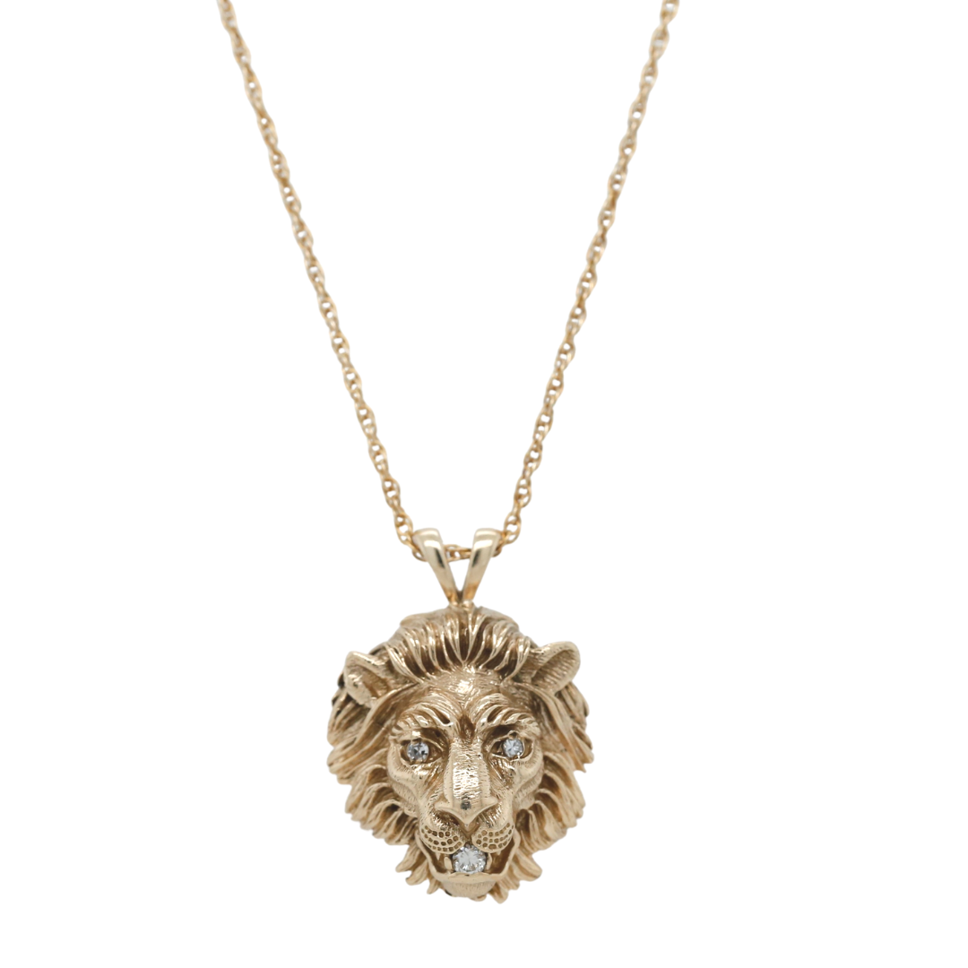 14k yellow gold estate lionhead pendant with three dainty diamonds and an 18in long chain