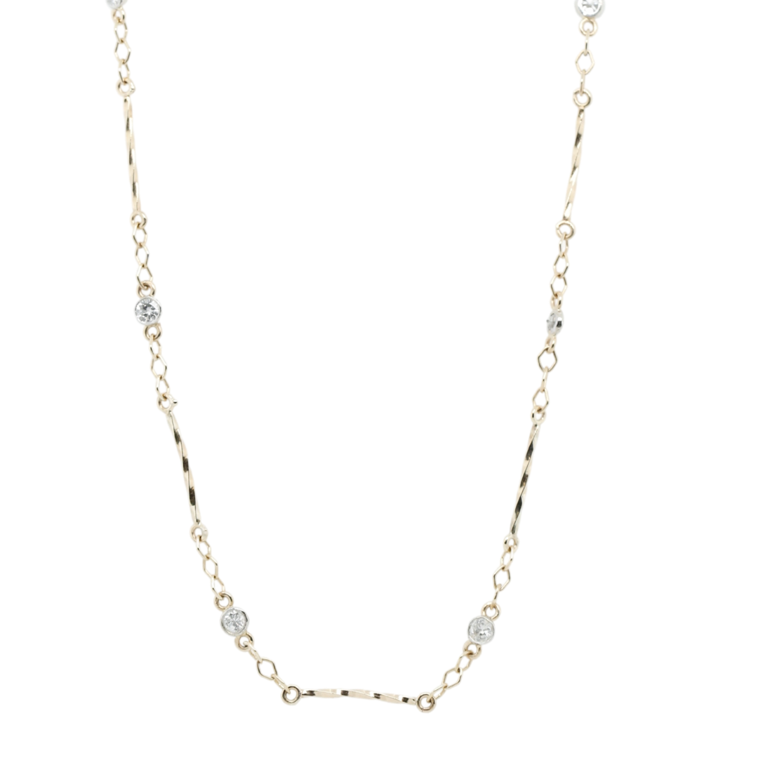 14k yellow and white gold bezel set diamond station necklace with twisted gold bar stations in between