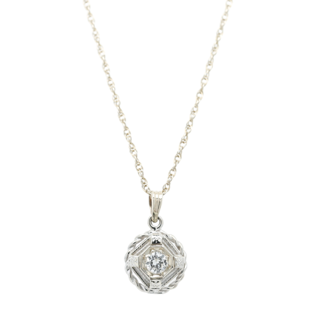 14k yellow and white gold diamond estate pendant bezel set in an intricate setting