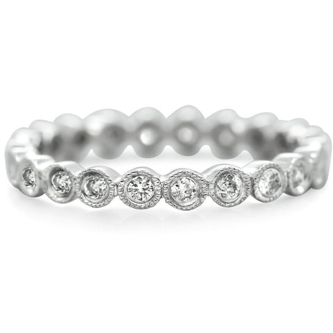 white gold estate eternity band with bezel set and milgrain white diamonds all the way around.