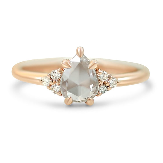 14k rose gold pear shaped rose cut diamond engagement ring with round diamond clusters prong set on either side