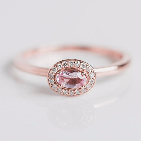 pink gemstone and diamond halo ring