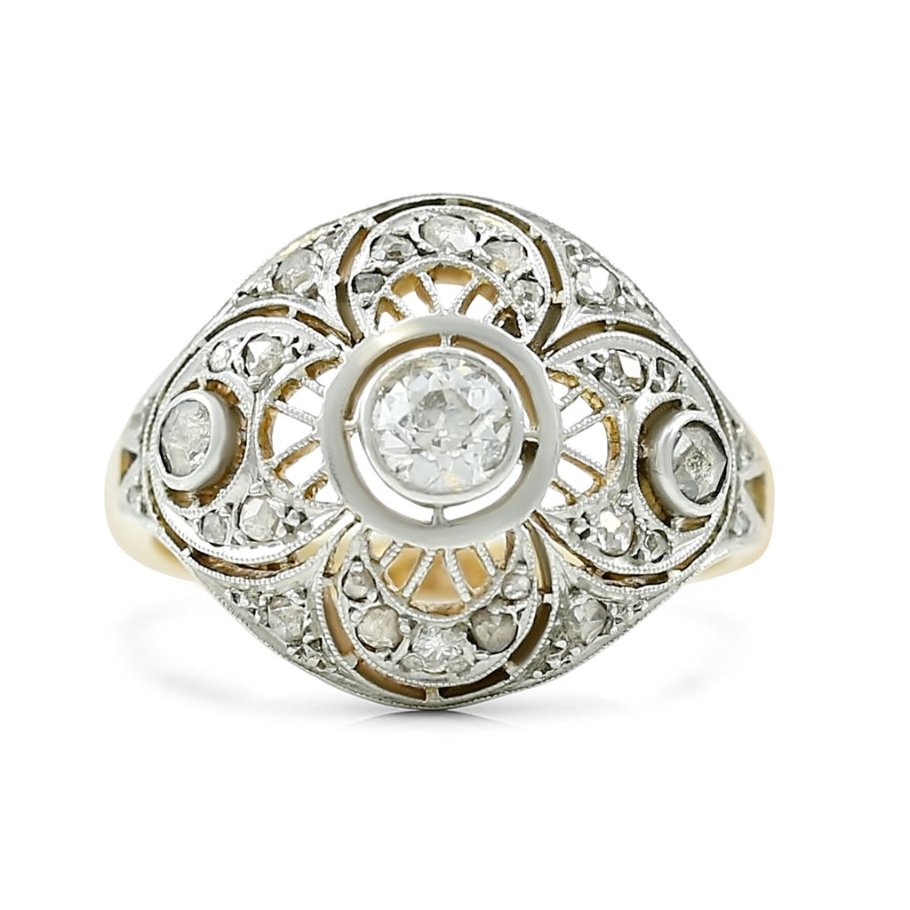 antique engagement ring created circa 1915 OEC center stone with rose cut diamonds and filigree details 14k yellow gold and platinum