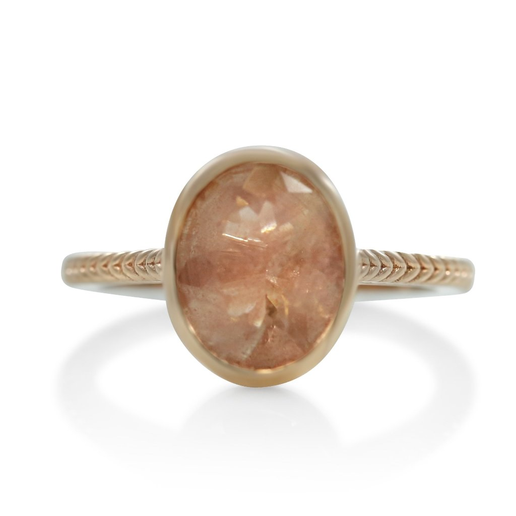 bezel set sunstone right hand ring with yellow gold rope band