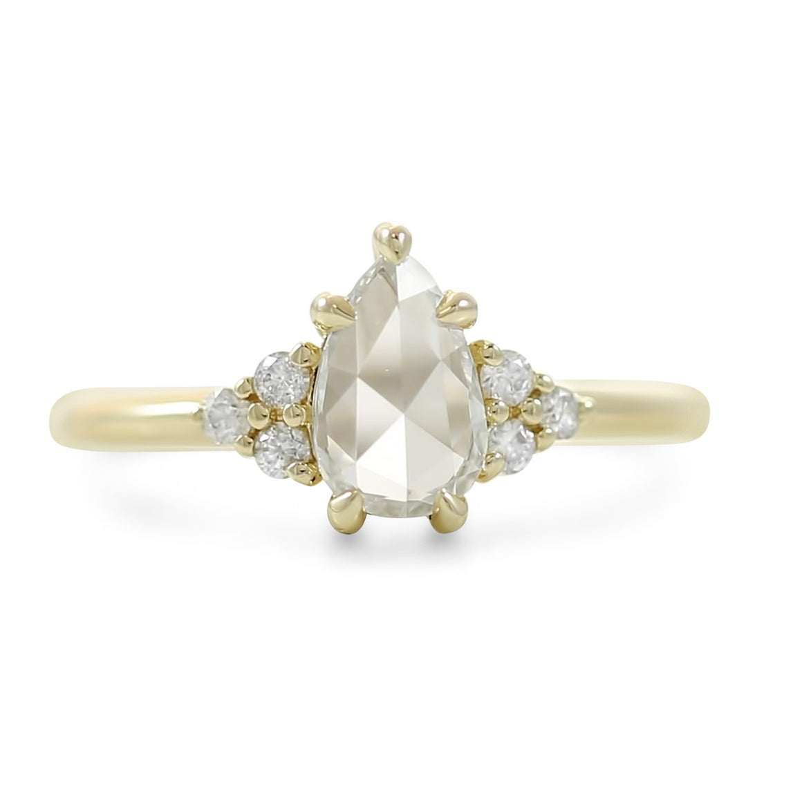 14k yellow gold rose cut pear diamond engagement ring with round diamond cluster side stones