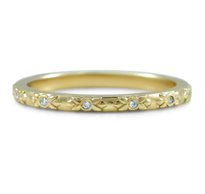 14k yellow, rose or white gold flower engraved wedding band with round bezel set diamonds around the band