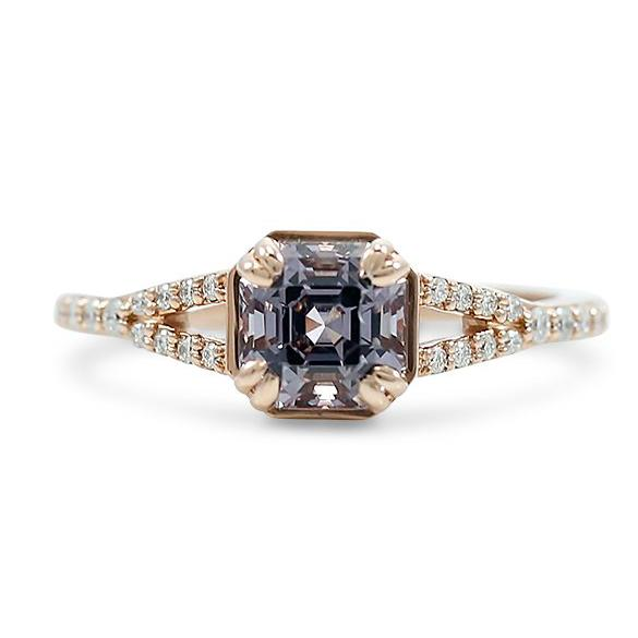 Tanzanian lavender spinel asscher cut center stone right hand ring with a rose gold split shank diamond band and double claw prongs