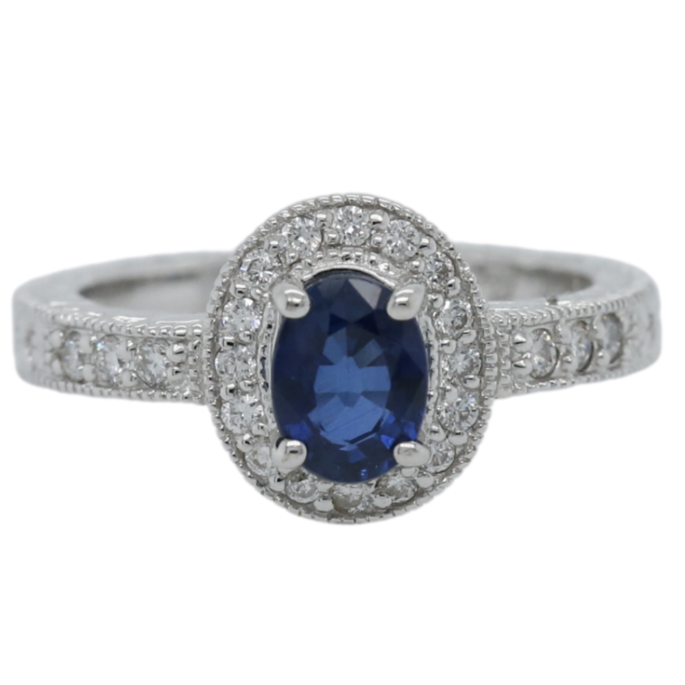 18k white gold oval sapphire engagement ring with a matching diamond halo and lots of engraved and milgrain details
