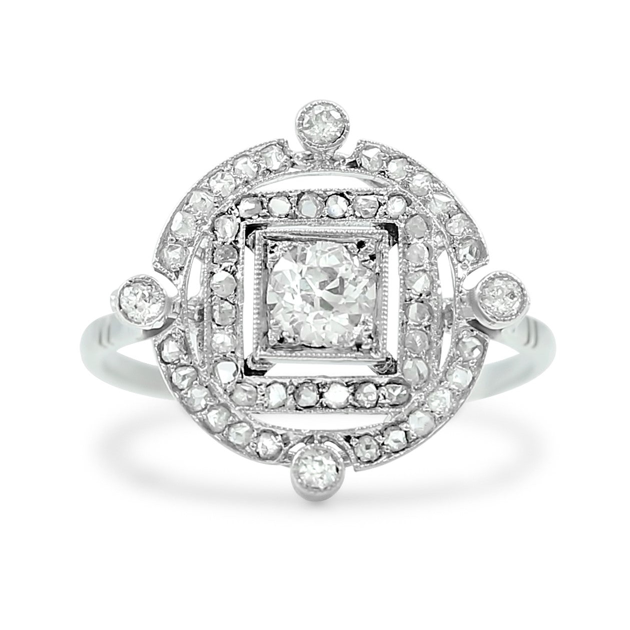 c. 1920 old european cut diamond center stone antique engagement ring set in platinum with a double diamond halo