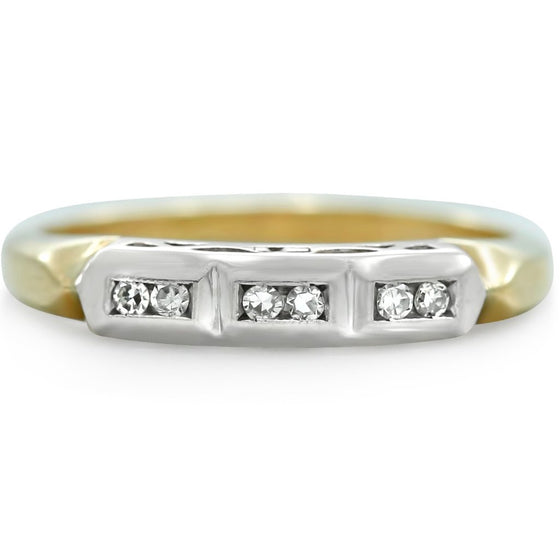a 1940s estate wedding band with yellow gold and two toned metals. Six single cut diamonds