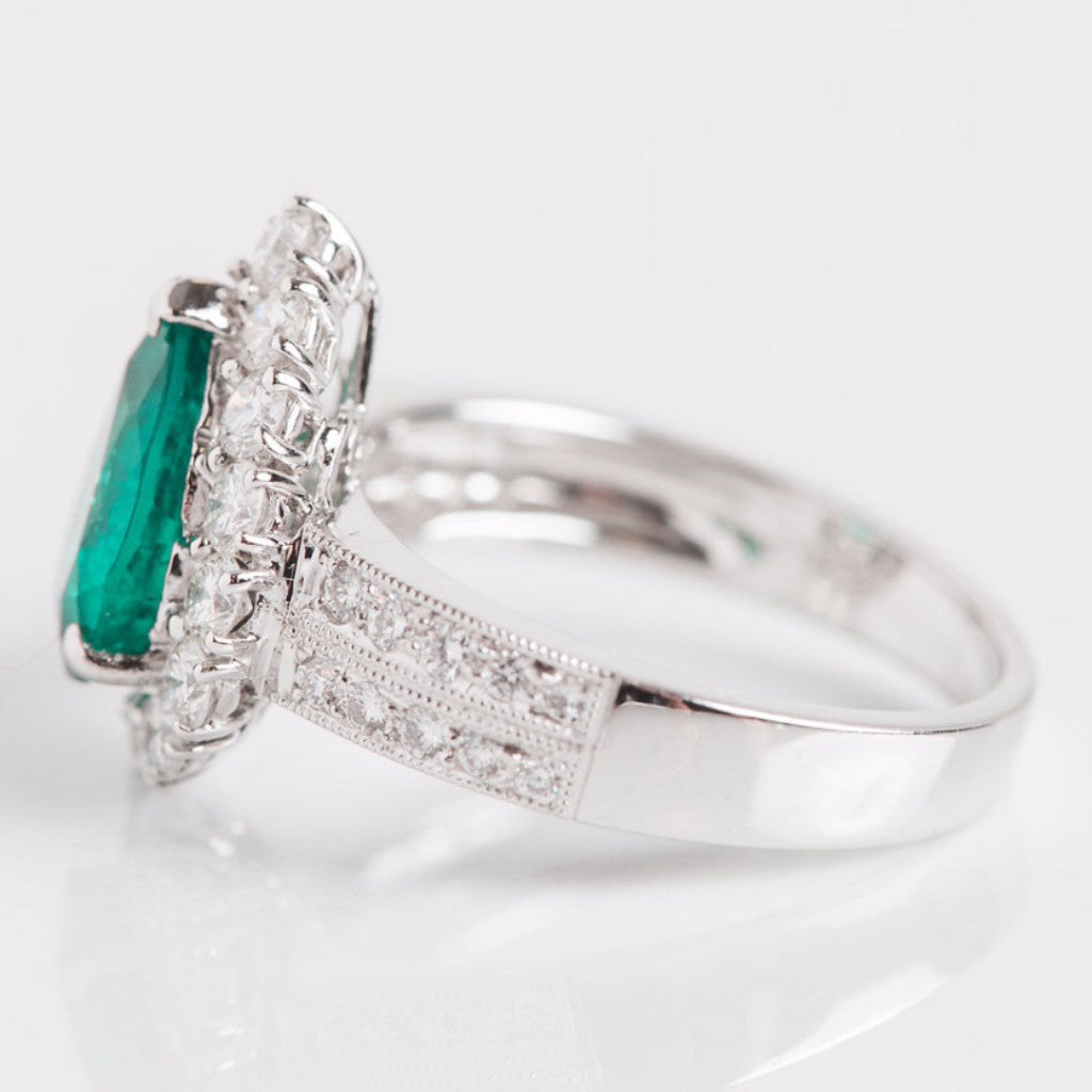 White Gold Diamond Halo and Turqoise Gemstone Pear Ring Side View