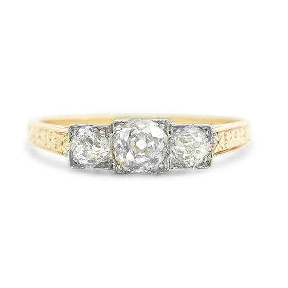 three stone antique engagement ring with engraved pattern on the 14k yellow gold band ~0.61tcw round diamonds