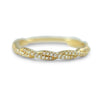 14k yellow gold twisted wedding band band with ~1/6tcw round diamonds