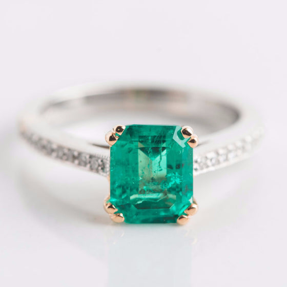 yellow and white gold with green gemstone ring