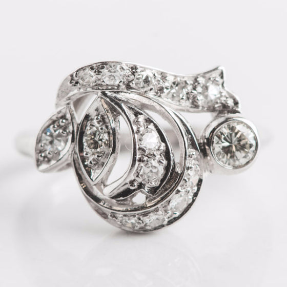 white gold and diamond swirl ring