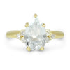 14k yellow gold pear shaped aquamarine engagement ring with clusters of white diamonds on both sides