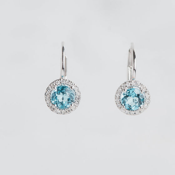 white gold blue topaz and diamond halo earrings