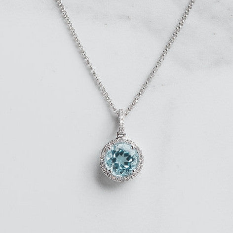 blue gemstone and diamond halo pendant necklace