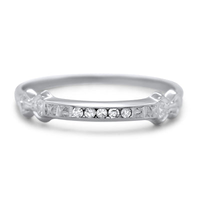 18k white gold channel set diamond antique wedding band with  an engraved pattern