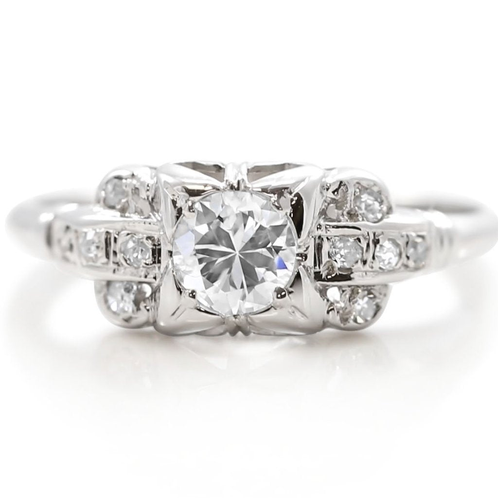 Art Deco estate engagement ring with 18 karat white gold and diamond center stone