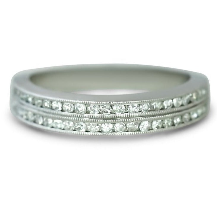 platinum channel set double row estate diamond wedding band with knife edges and milgrain details.