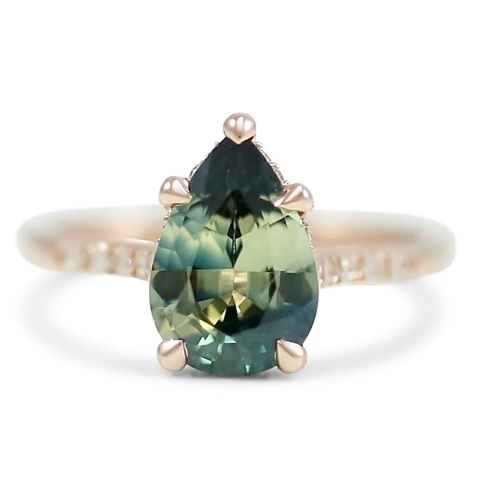 14k rose gold pear shaped green heated Australian sapphire engagement ring with a hidden diamond halo