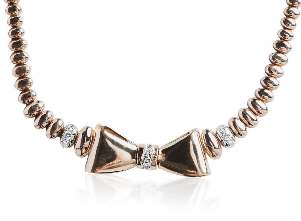 yellow gold estate bow tie necklace with white diamonds