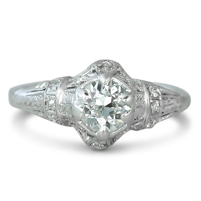 platinum old european cut diamond estate engagement ring with filligree and engraved details and round diamond throughout