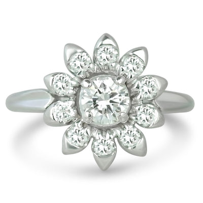 Platinum antique flower diamond engagement ring made up of round diamonds
