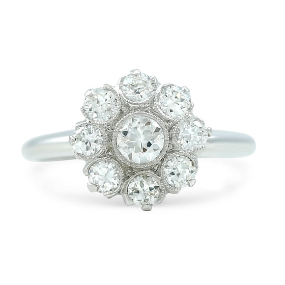 0.65tcw diamond flower antique engagement ring set in 18k white gold made c. 1920 old european cut diamond center stone