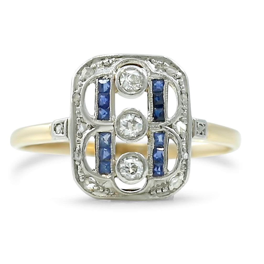 art deco antique engagement ring with baguette sapphires and bezel set round diamonds unique shape and set in platinum and 14k yellow gold