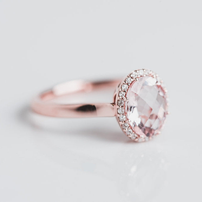 rose gold, diamond halo and pink gem ring